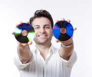 Man holding a cd Royalty Free Stock Photography