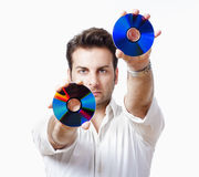 Man holding cd. Man in white shirt standing holding CD - isolated on white Stock Photography