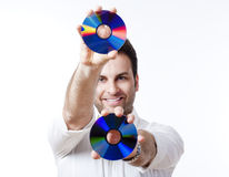 Man holding a cd. Man in shirt standing smiling holding CD - isolated on white Stock Photo