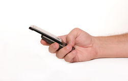 Man holding Cell Phone. Isolated image of a man holding a Cell phone Stock Photo