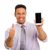 Man holding cell phone. Happy middle aged man holding cell phone and giving thumb up Royalty Free Stock Photography