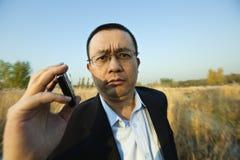 Man holding a cellphone Stock Photos