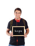 Man holding chalkboard with. Close up of a young handsome man holding chalkboard with text `hope`. Isolated white background stock images