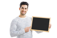 Man holding a chalkboard Royalty Free Stock Photography