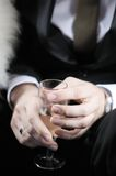 Man  holding champagne glass. Groom holding wedding champagne glass Royalty Free Stock Photo