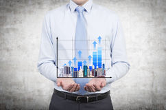 Man holding chart and skyscraper Royalty Free Stock Photo