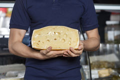 Man Holding Cheese In Grocery Store Stock Photography