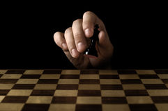 Man holding chess piece Royalty Free Stock Photo
