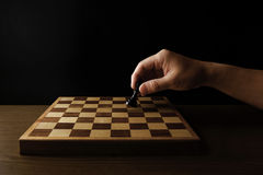 Man holding chess piece. Close-up photography Royalty Free Stock Image