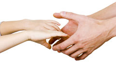 Man holding a child by the hand. Man holding a child's hands on a white background Stock Images