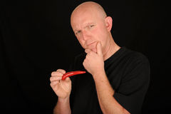 Man holding chili Royalty Free Stock Photos