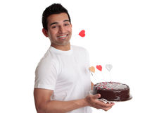 Man holding chocolate cake with love hearts