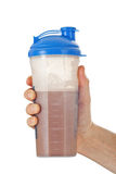 Man holding chocolate whey protein shake Stock Images