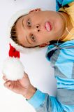 Man holding christmas hat and pulling his face Royalty Free Stock Images