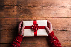 Man holding Christmas present Stock Images