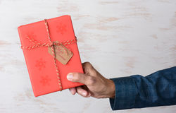 Man Holding Christmas Present Wood Background Royalty Free Stock Photo