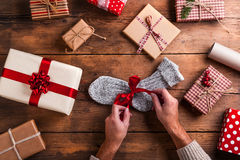 Man holding Christmas presents Stock Images