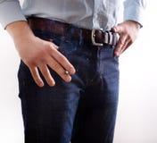 Man holding cigar in hand beside pocket Stock Image