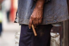 Man holding a cigar in the street of Havana, Cuba Royalty Free Stock Image