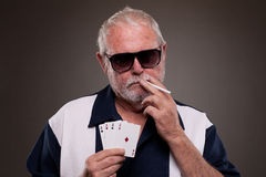 Man holding cigarette and four aces Stock Images