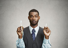 Man holding cigarette and toothbrush Stock Photography