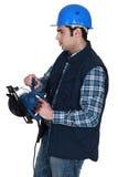 Man holding circular saw Stock Photography