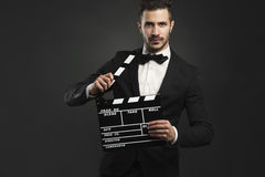 Man holding a clapboard Royalty Free Stock Photography