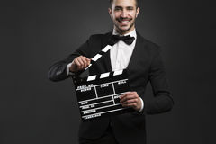 Man holding a clapboard Royalty Free Stock Photo