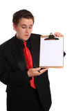 Man holding Clipboard with blank page Stock Photos