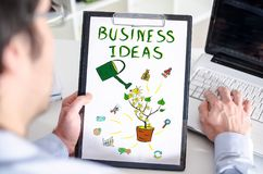Business ideas concept on a clipboard. Man holding a clipboard with business ideas concept Stock Photos