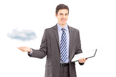 Man holding a clipboard and gesturing with hand, symbolizing clo Royalty Free Stock Photo