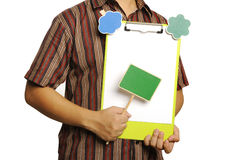 Man Holding Clipboard With Wooden Sign Stock Photography