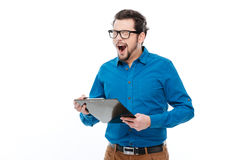 Man holding clipboard and yawning Royalty Free Stock Photography
