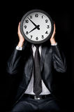 Man holding clock Royalty Free Stock Image