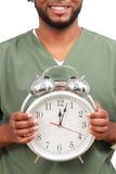 Man holding a clock Stock Photography