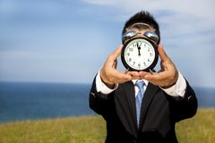 Man holding clock Royalty Free Stock Photography