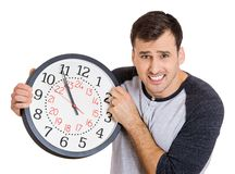 Man holding clock Stock Images