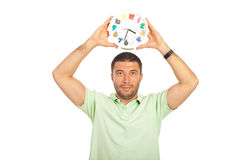 Man holding clock over his head Royalty Free Stock Image