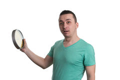 Man Holding A Clock Over White Background Royalty Free Stock Image