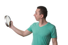 Man Holding A Clock Over White Background Stock Photos