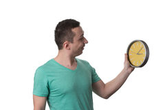 Man Holding A Clock Over White Background Royalty Free Stock Photography