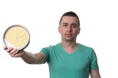 Man Holding A Clock Over White Background Royalty Free Stock Photos
