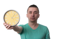 Man Holding A Clock Over White Background Royalty Free Stock Images