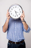 Man holding clock, show time to you. Stock Images