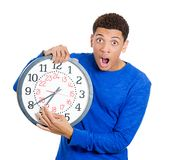 Man holding a clock very stressed Royalty Free Stock Photography