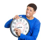 Man holding a clock very stressed Royalty Free Stock Images
