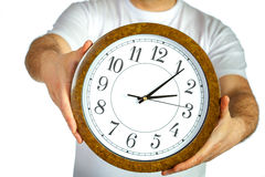Man holding clock Royalty Free Stock Images
