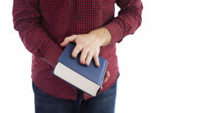 Man holding closed book isolated on white. Man holding large closed book with blank cover, isolated on a white background royalty free stock image