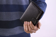 Man holding a closed wallet Stock Images