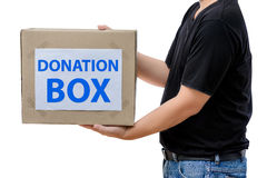 Man holding clothes donation box Stock Images
